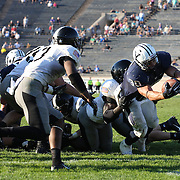 Tyler Varga, Yale, goes over for the game winning touchdown in overtime during his five touchdown display during the Yale V Army, Football match at Yale Bowl, New Haven. Yale won the match 49-43 in overtime in front of a crowd of 34,142. New Haven, Connecticut, USA. 27th September 2014. Photo Tim Clayton