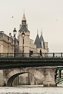 France. Paris. 1st district. the Arcole bridge .  Ile de la Cite, Paris, France. The spires of the Conciergerie rise above the Seine in Paris / Le clocher de la  conciergerie, la seine.