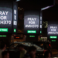 An electronic sign showing Pray for MH370 is seen at the street in Kuala Lumpur, Malaysia 24 March 2014. Malaysian Prime minister Najib Razak announces that Malaysian missing airlines MH370 has ended in south Indian Ocean.