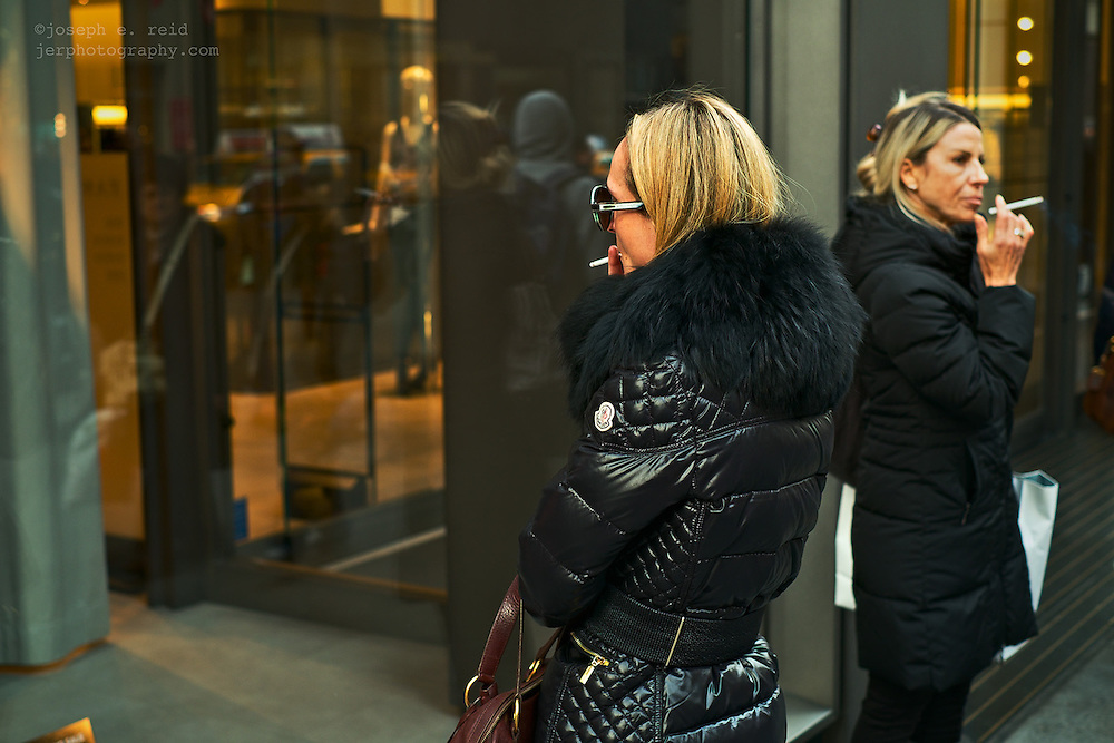 Two women smoking outside 5th Avenue store