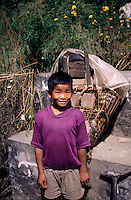 A young boy works as a porter in the Himalayan mountains of Nepal.