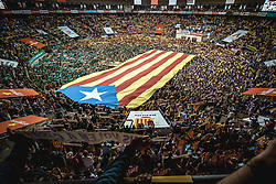 October 7, 2018 - Tarragona, Catalonia, Spain - Castellers hold placards reading 'we want them home' in support of imprisioned Catalan politics and a giant 'Estelada' flag at the beginning of day two of the 27th Tarragona Human Tower Competition in Tarragona. The competition takes place every other year and features the main 'Castellers' teams (colles) of Catalonia during a three day event organized by the Tarragona City Hall (Credit Image: © Matthias OesterleZUMA Wire)