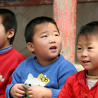 Asia, China, Beijing. Kindergarten children singing