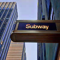 Square image of a subway sign in Midtwon Manhattan.