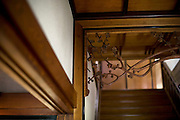 "Photo shows  the delicately carved woodwork at the head of the staircase leading to the 2nd floor of the main building of the Honma Museum of Art in Sakata, Yamagata Prefecture, Japan, on July 06, 2012. While construction of the first floor was started around 200 years ago, the second floor was added 100 years later in preparation for a visit of the then emperor. While sickness prevented the emperor's visit, his son, who was to later become emperor Showa, stayed at what is known as the Seienkaku -- or "" Pure and Distant Palace. The woodwork seen here was hand carved from a single 10-cm-thick piece of wood.  Photographer: Robert Gilhooly."