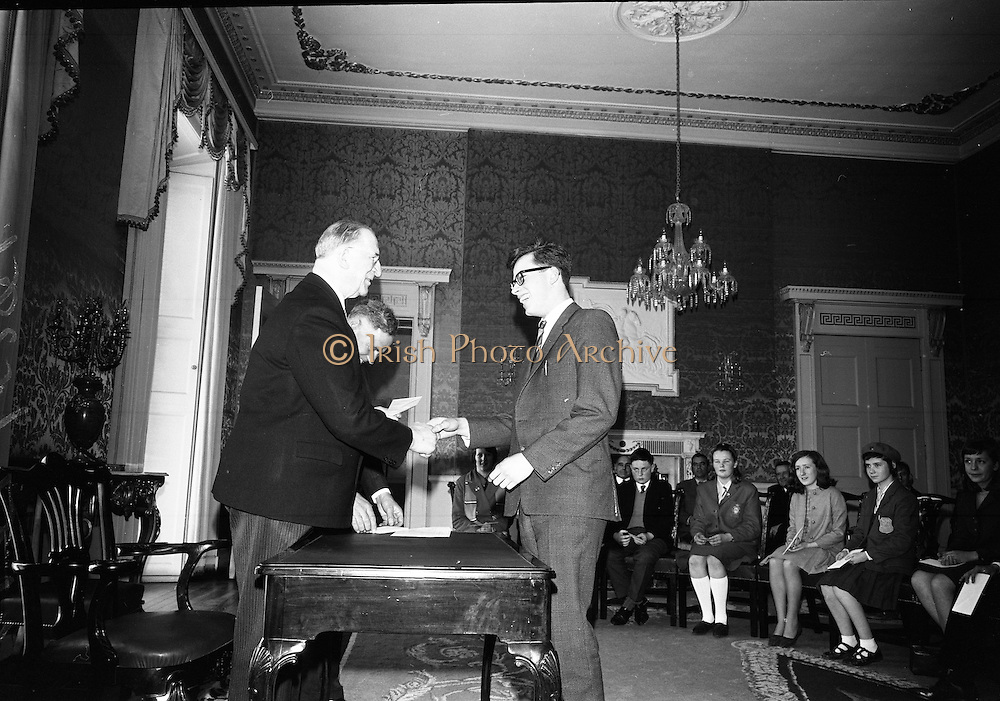 28/04/1966<br /> 04/28/1966<br /> 28 April 1966<br /> President Eamon de Valera presents prizes at Aras an Uachtarain. The President presented the prizes to the winners of competitions for schoolchildren organised by the Golden Jubilee 1916 Committee. The winners from schools all over Ireland competed in competitions for essays and poetry in Irish and English. Picture shows President de Valera presenting 1st prize of £50 in competition of Irish original Poetry to Aogán E. Ó Muircheartaigh, 33 Ascal Frankfurt, Rath Garbh, Baile Atha Cliath of Colaiste Mhuire.