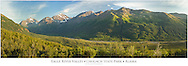 Composite panorama of evening sun on Polar Bear and Eagle Peaks and Hurdygurdy Mountain overlooking Eagle River Valley in Chugach State Park in Southcentral Alaska. Summer.