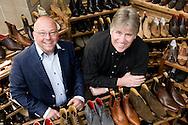 Nederland, Waalwijk, 20090420.<br /> Schoenfabriek H. Greve in Waalwijk.<br /> Jos Jan Greve (l), de vierde generatie die nu het bedrijf leidt, en Wim van Soest (r) de eigenaar (groot)<br /> handgemaakte schoenen uit Waalwijk sinds 1898. Ze zijn hofleverancier.<br /> In het hart van de Langstraat, in de stad Waalwijk, begon Hermanus Greve in 1898 een schoenmakerij. Vanaf het prille begin had de werkplaats slechts &eacute;&eacute;n doel voor ogen: Nederlands meest stijlvolle en superieure schoenen maken. Greve is daardoor altijd &eacute;&eacute;n van de kleinere werkplaatsen van de Langstraat geweest maar tegelijk ook de meest exclusieve. De herinnering aan een rijk verleden leeft hier vandaag de dag nog steeds voort. We zijn een trots familiebedrijf dat onder leiding staat van inmiddels de 4e generatie, Jos Jan Greve.<br /> <br /> Netherlands, Waalwijk, 20090420. <br /> Shoe industry Greve in Waalwijk. <br /> handmade shoes from Waalwijk since 1898.<br /> In the heart of the Langstraat, in the city of Waalwijk, Hermanus Greve started in 1898 a shoemaker. From the very beginning, the workshop is only one goal: to make Dutch most stylish and superior shoes. Greve has therefore always been one of the smaller workshops of Langstraat but it is also the most exclusive. The memory of a glorious past alive here today still continues. We are a proud family business headed by now the 4th generation, Jos Jan Greve.