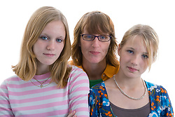 Portrait of a mother with her teenage daughters in the studio,