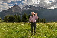 The famous musician Domenic Janett in the shadow of the Piz Ela, Bergün, Parc Ela, Grisons, Switzerland