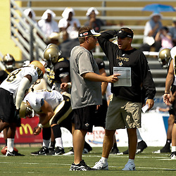 August 1, 2010; Metairie, LA, USA; New Orleans Saints head coach Sean Payton and defensive coordinator Gregg Williams talk during a training camp practice at the New Orleans Saints practice facility. Mandatory Credit: Derick E. Hingle