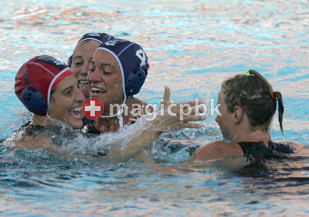 Manuela Zanchi (R) of Italy is congratulated by goalkeeper Francesca Conti (L) and other teammates after she socred the winning goal in the last seconds of the women's semi-final Water Polo game USA vs Italy of the Athens 2004 Olympic Games, Tuesday 24 August 2004. Italy won 6-5 to advance to the finals.     (Photo by Patrick B. Kraemer / MAGICPBK)