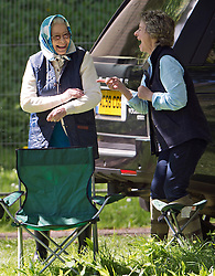 © London News Pictures. 12/05/2012. Windsor, UK. HRH Queen Elizabet II sharing a joke with friend Pattie Biden while  watching The Land Rover International Driving competition on day four of the Royal Windsor Horse Show in the grounds of Windsor Castle, Berkshire,  on May 12, 2012. Photo credit: Ben Cawthra/LNP