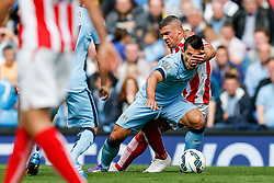 Sergio Aguero of Manchester City is caught in the face by Jonathan Walters of Stoke - Photo mandatory by-line: Rogan Thomson/JMP - 07966 386802 - 30/08/2014 - SPORT - FOOTBALL - Manchester, England - Etihad Stadium - Manchester City v Stoke City - Barclays Premier League.