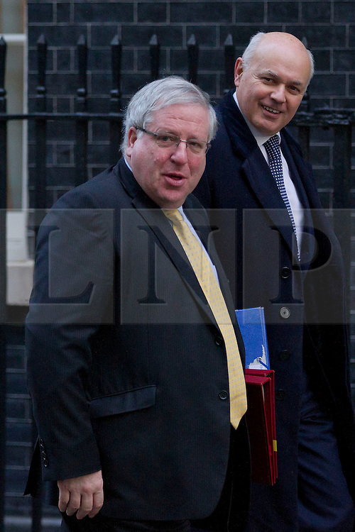 © Licensed to London News Pictures. 26/11/2013. London, UK. The Work & Pensions Secretary, Iain Duncan Smith (R), arrives with the Transport Secretary, Patrick McLoughlin, for a meeting of British Prime Minister David Cameron's Cabinet on Downing Street in London today (26/11/2013). Photo credit: Matt Cetti-Roberts/LNP