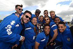 Bristol Rovers players celebrate with the Vanarama Conference Play-Off Final trophy - Photo mandatory by-line: Dougie Allward/JMP - Mobile: 07966 386802 - 25/05/2015 - SPORT - Football - Bristol - Bristol Rovers Bus Tour