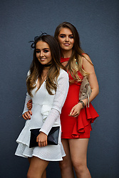 LIVERPOOL, ENGLAND - Thursday, April 6, 2017: Liv Owens [L], 18 from Liverpool, wearing a dress from Miss Guided and Isabel Bennett, 18 from Liverpool, wearing a bespoke dress from Phil Bowyer, during The Opening Day on Day One of the Aintree Grand National Festival 2017 at Aintree Racecourse. (Pic by David Rawcliffe/Propaganda)