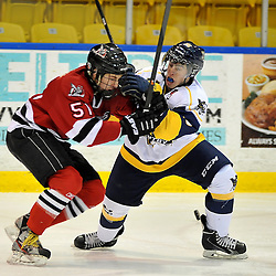 WHITBY, ON - Feb 2: Ontario Junior Hockey League game between Mississauga Chargers and Whitby Fury. Patrick McAuliffe 25 of the Whitby Fury Hockey Club defends against Ayrton Valente #51 of the Mississauga Chargers Hockey Club during third period game action.<br /> (Photo by Shawn Muir / OJHL Images)