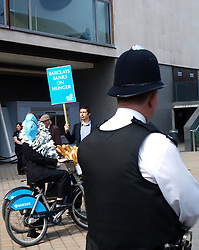 Campaigners from The World Development Movement, accusing barclays bank of contributing to world hunger outside Barclays' Annual General Meeting at London's Royal Festival Hall, London, UK, Thursday April 25, 2013, Photo Max Nash / i-Images