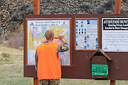 Hunter Dominic Weldon studies a block management map at the Ruby Dell Ranch east of Dillon, Montana