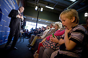 Logan Phillis, 7, of Ames Iowa, plays as Former Sen. Fred Thompson (R-Tenn.), and 2008 Republican presidential candidate, speaks to supporters at the Olde Maine Brewing Company in Ames, Iowa, Sunday December 30, 2007.