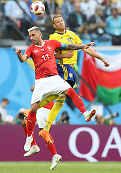 SAINT PETERSBURG, July 3, 2018  Valon Behrami (L) of Switzerland vies with Ola Toivonen of Sweden during the 2018 FIFA World Cup round of 16 match between Switzerland and Sweden in Saint Petersburg, Russia, July 3, 2018. Sweden won 1-0 and advanced to the quarter-final. (Credit Image: © Cao Can/Xinhua via ZUMA Wire)