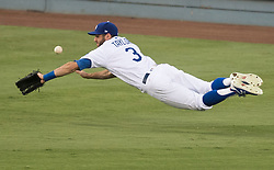 October 25, 2017 - Los Angeles, California, U.S. - The Los Angeles Dodgers' CHRIS TAYLOR can't come up with the ball on a Alex Bregman RBI single in the third inning during game two of the World Series against the Houston Astros at Dodger Stadium. (Credit Image: © Kevin Sullivan/Los Angeles Daily News via ZUMA Wire)