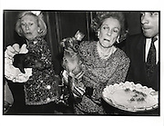Dachshunds fighting over canapes, ris Love and Brooke Astor with Just Desserts and Dolly Astor at a Dachund party. Barbetta. Manhattan. 12 February 1990