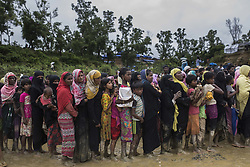 September 19, 2017 - Cox'S Bazar, CHITTAGONG, BANGLADESH - Rohingya refugees accept food help from NGO's, September 19th, 2017, Cox's Bazaar, Bangladesh. Many of the Rohingya fleeing the violence in Myanmar had travelled by boat to find refuge in neighbouring Bangladesh. According to United Nations more than 300 thousand Rohingya refugees have fled Myanmar from violence over the last few weeks, most trying to cross the border and reach Bangladesh. (Credit Image: © Can Erok/Depo Photos via ZUMA Wire)
