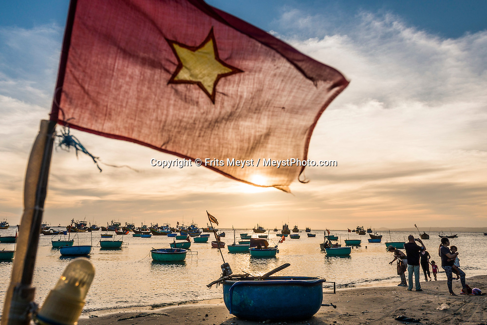 Phan Thiet, Vietnam, November 2016. Fishermen prepare for the catch of the day on the beach of Phan Thiet, which is the largest fish sauce producer of Vietnam. Phan Thiet is a quiet beach resort town on the South China sea. Vietnam is a popular Asian travel destination for tourists and travelers. Photo by Frits Meyst / MeystPhoto.com
