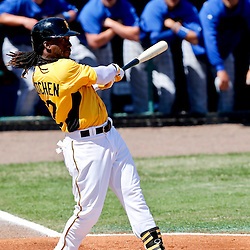 Mar 13, 2013; Bradenton, FL, USA; Pittsburgh Pirates center fielder Andrew McCutchen (22) flies out against the Toronto Blue Jays during the bottom of the first inning of a spring training game at McKechnie Field. Mandatory Credit: Derick E. Hingle-USA TODAY Sports