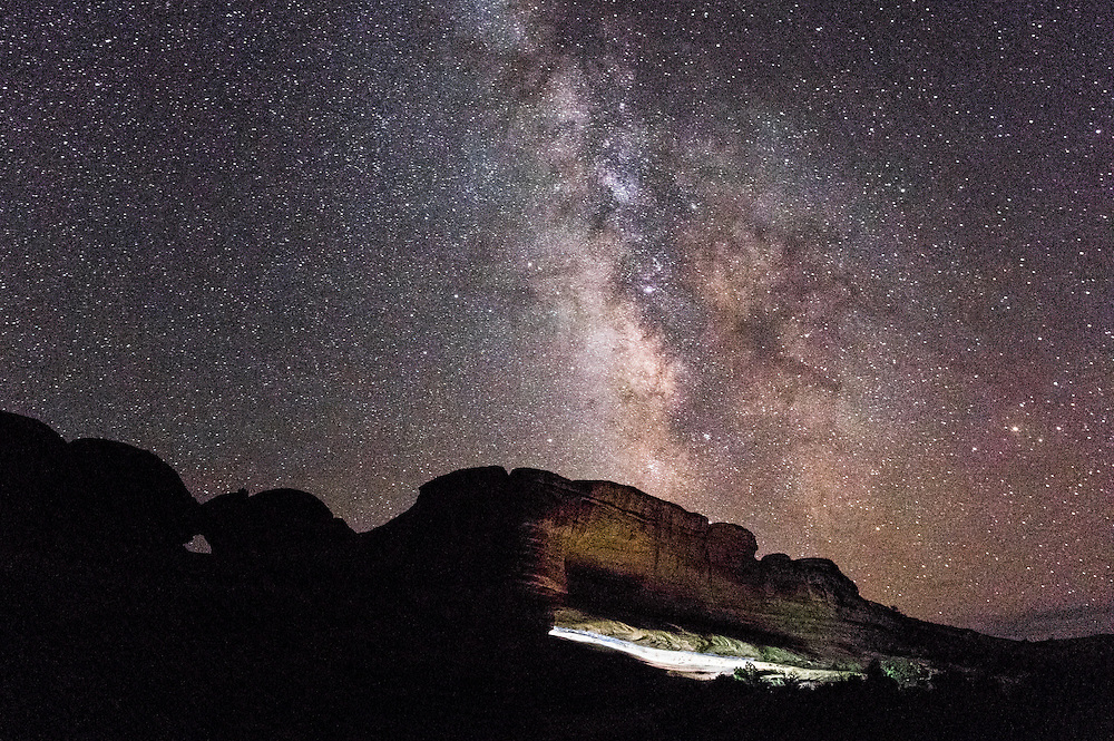 The Milky Way rising over the path to Delicate Arch in Arches National Park, Utah.
