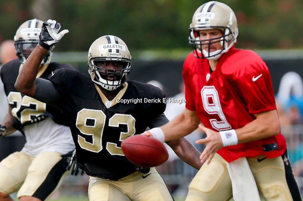 Aug 3, 2013; Metairie, LA, USA; New Orleans Saints linebacker Junior Galette (93) rushes quarterback Drew Brees (9) during a scrimmage at the team training facility. Mandatory Credit: Derick E. Hingle-USA TODAY Sports