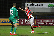 Will Boyle heads in the 2nd goal of the game and runs off to celebrate   during the EFL Sky Bet League 2 match between Mansfield Town and Cheltenham Town at the One Call Stadium, Mansfield, England on 7 December 2019.