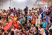 10 AUGUST 2012 - PHOENIX, AZ: The crowd during Janmashtami at Ekta Mandir, a Hindu temple in central Phoenix. Janmashtami is the Hindu holy day that celebrates the birth of Lord Krishna. Hindu communities around the world celebrate the holy day. In Arizona, most of the Hindu temples in the Phoenix area have special celebrations of the day.  PHOTO BY JACK KURTZ