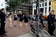 Frankfurt am Main | 05 July 2014<br /> <br /> Am Samstag (05.07.2014) demonstrierten in Frankfurt am Main etwa 250 Menschen aus der linksradikalen Szene gegen die deutsche Fl&uuml;chtlingspolitik, gegen Abschiebungen und f&uuml;r das Bleiberecht gefl&uuml;chteter Menschen in Deutschland und anderswo.<br /> Hier: Die Demo im Bankenviertel, junge Menschen in schicker Kleidung gaffen.<br /> <br /> [Foto honorarpflichtig, kein Model Release]<br /> <br /> &copy;peter-juelich.com