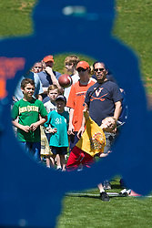 Fans try to throw a football through a hole as on the field at Scott Stadium.  The Virginia Cavaliers football team played the annual spring football scrimmage at Scott Stadium on the Grounds of the University of Virginia in Charlottesville, VA on April 18, 2009.  (Special to the Daily Progress / Jason O. Watson)