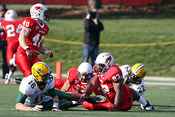 17 November 2012:  Brock Jensen gets up off the turf after being hammered by Shelby Harris during an NCAA Missouri Valley Football Conference football game between the North Dakota State Bison and the Illinois State Redbirds at Hancock Stadium in Normal IL