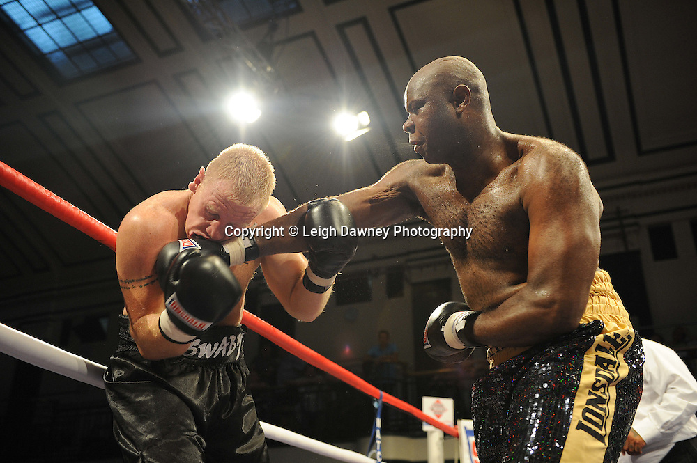 Matt Skelton (black/Gold shorts) defeats Lee Swaby on the 9th July 2010 at York Hall, Bethnal Green, London. Promoter: Matchroom Sport. Photo credit: © Leigh Dawney