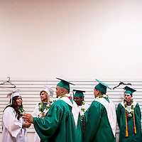 051613       Cable Hoover<br /> <br /> Gallup Catholic High School graduates gather together before moving across the street to El Morro Theater for their graduation ceremony Thursday in Gallup.