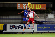 AFC Wimbledon defender Paul Kalambayi (30) battles for possession with Stevanage attacker Danny Newton (19) during the EFL Trophy group stage match between AFC Wimbledon and Stevenage at the Cherry Red Records Stadium, Kingston, England on 6 November 2018.