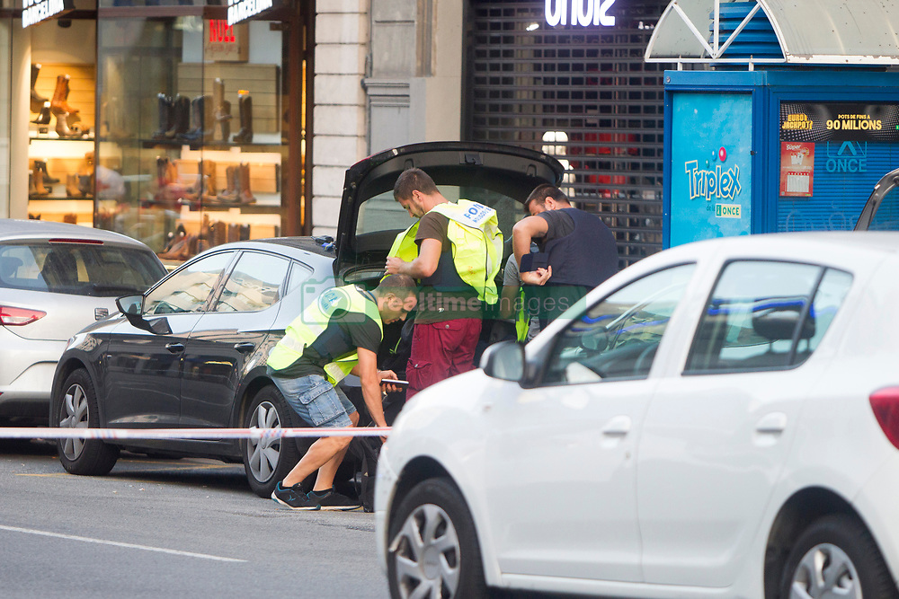 Spanish policemen stand guard in a cordoned off area after a van ploughed into the crowd, killing 13 persons and injuring over 50 on the Rambla in Barcelona, Spain on August 17, 2017. A driver deliberately rammed a van into a crowd on Barcelona's most popular street on August 17, 2017 killing at least 13 people before fleeing to a nearby bar. Officers in Spain's second-largest city said the ramming on Las Ramblas was a 'terrorist attack'.  (Photo by Hugo Fernández Alcaraz/NurPhoto/Sipa USA)