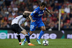 April 18, 2018 - Valencia, Valencia, Spain - Guedes (L) of Valencia CF competes for the ball with Damian of Getafe CF during the La Liga game between Valencia CF and Getafe CF at Mestalla on April 18, 2018 in Valencia, Spain  (Credit Image: © David Aliaga/NurPhoto via ZUMA Press)