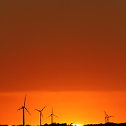 Power generating wind farms at sunset near Dwight, in central Illinois. Available in Raw format.<br />