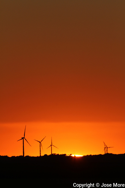 Power generating wind farms at sunset near Dwight, in central Illinois. Available in Raw format.<br /> Photography by Jose More