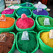Colored christmas sands for nativity displays on sale at Antigua's main market, Guatemala.