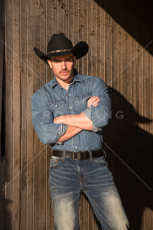 Rugged cowboy with arms crossed