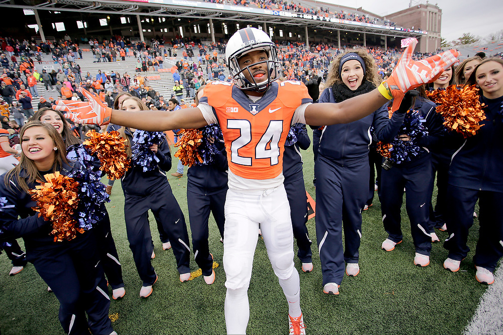 Illinois defensive back Darius Mosely (24) celebrates by dancing with the Illinettes after an NCAA college football game at Memorial Stadium Saturday, Nov. 22, 2014, on the University of Illinois campus in Champaign, Ill. Illinois won the game 16-14. (Lee News Service/ Stephen Haas)