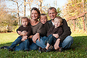 Parents Kira and Kurt Femrite are pictured with their children, Will, 7, Erik, 4, and Ella, 19 months, during a family portrait session outdoors at their home in Cottage Grove, Wis., during autumn on Oct. 16, 2011. (Photo by Jeff Miller, www.jeffmillerphotography.com)