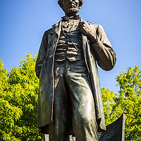 "Abraham Lincoln statue in Chicago. Named ""The Man"" and also called ""Standing Lincoln"", the bronze statue is located in Lincoln Park in Chicago"
